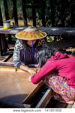 Shan, Myanmar- December 2015 - women make paper from natural fiber in Inle lake area, Shan, Myanmar
