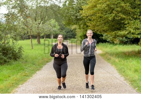 Pair Of Beautiful Friends Jogging Together