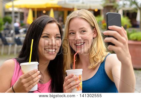 Cute Women With Beverages Taking Self Portrait
