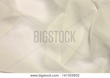 This is a photograph of White sheer fabric