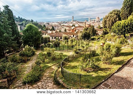View from Giardino delle Rose to the city of Florence. Tuscany Italy. Travelling scene. Beauty photo filter. Greenery and town. Cradle of the renaissance. Cultural heritage.