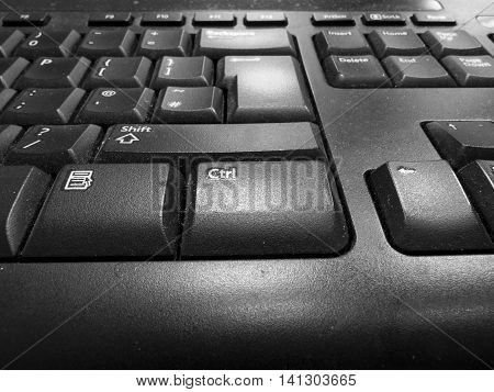 Dusty old black keyboard with focus on the control key