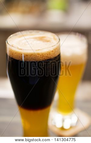Glasses - two pints- of dark beer and lager with foam