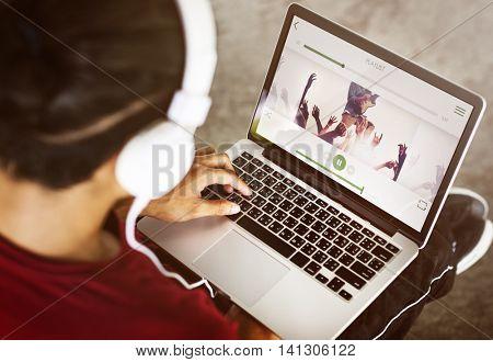 Boy Headphones Laptop Playlist Concept