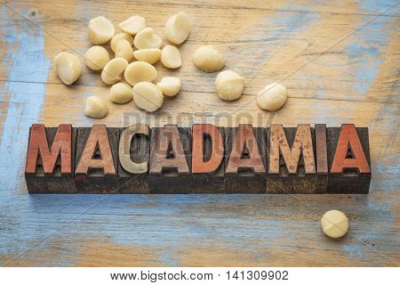 macadamia nuts with a word spelled in letterpress wood type