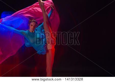 The art photo-emotional dance of beautiful girl in blue dress