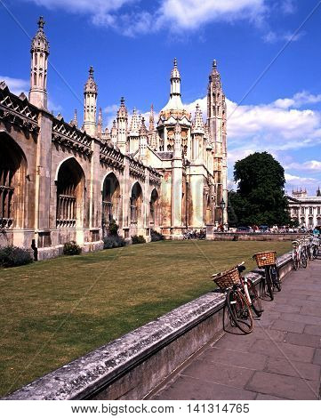 CAMBRIDGE, UNITED KINGDOM - JULY 8, 1992 - Entrance to Kings College on Kings Parade with bicycles in the foreground Cambridge Cambridgeshire England United Kingdom Western Europe, July 8, 1992.