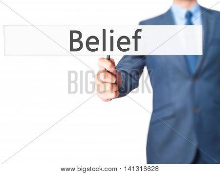 Belief - Businessman Hand Holding Sign