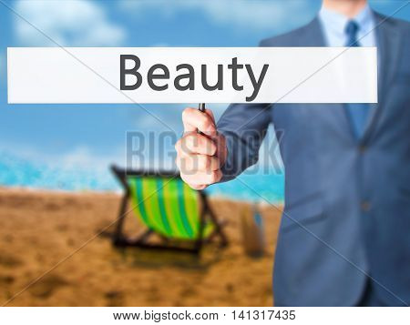 Beauty - Businessman Hand Holding Sign