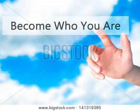 Become Who You Are - Hand Pressing A Button On Blurred Background Concept On Visual Screen.