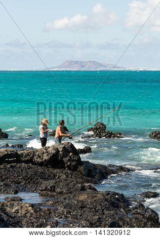 FUERTEVENTURA, SPAIN - SEPTEMBER 17, 2015: Spinning fisherman in Corralejo on Fuerteventura Spain