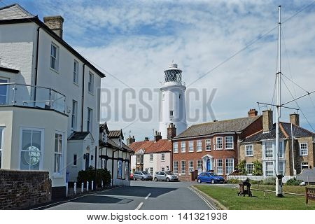 The coastal town of Southwold, Suffolk, with its  lighthouse in the streets behind the seafront.