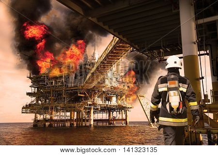 Fire fighter on oil and gas industry, successful firefighter at work , Fire suit for fighter with fire and suit for protect fire fighter, Security team when fire case and try to fight fire with team.
