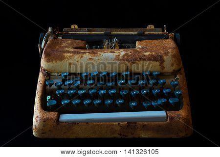Typewriter Waiting for Inspiration. Vintage Rusty Typewriter Machine. Journalist Equipment. Typewriter Isolated on Black Background.