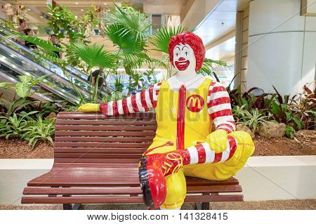 SINGAPORE - CIRCA NOVEMBER, 2015: Ronald McDonald character in Singapore Changi Airport. Ronald McDonald is a clown character used as the primary mascot of the McDonald's restaurant chain.