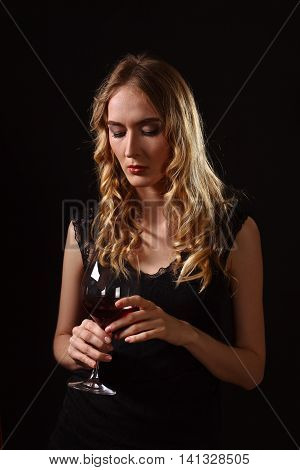 Beautiful Blonde In Black Dress With Glass Of Red Wine