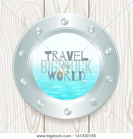 metal porthole with seascape on wooden background