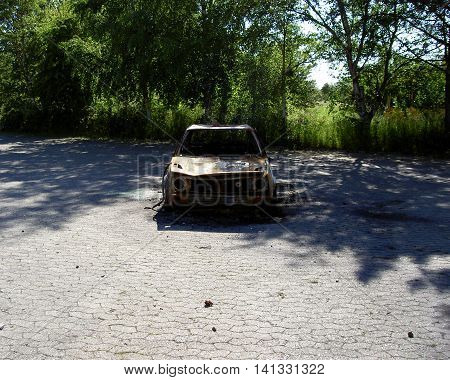 abandoned and burned out car in a forgotten place