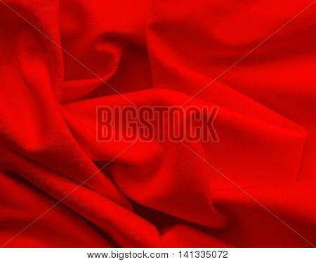 Red cloth or textile, wavy textile, close-up shot.