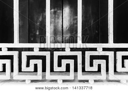 Detail of a white geometric grid of a window.