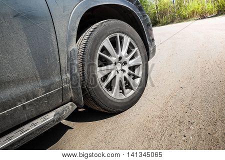 Unidentifiable Suv Car Fragment. Wheel