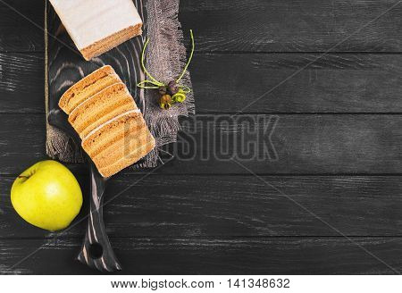 Blank apple biscuit pie fresh apples sacking on cutting board black wooden background surface empty place for text top view
