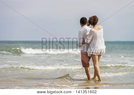 Young Couple Embracing Each Other On China Beach In Danang