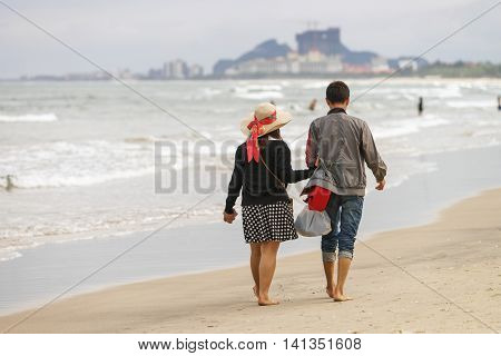 Young Couple Holding Hands At The China Beach Danang