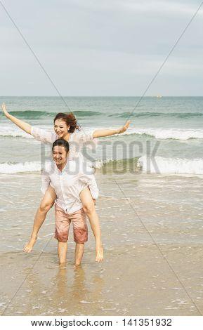 Young Couple Posing In China Beach In Danang In Vietnam