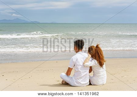 Young Couple Sitting And Looking At The Sea Of Danang