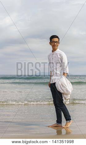 Young Fellow At China Beach Of Danang In Vietnam
