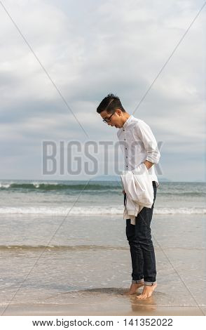 Young Fellow On China Beach In Danang In Vietnam