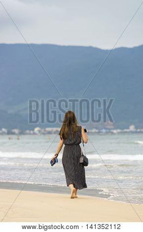 Young Girl Passing By At China Beach Danang