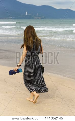Young Girl Passing By On China Beach In Danang