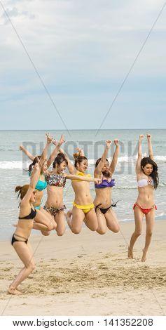 Young Girls Jumping At China Beach Of Danang In Vietnam