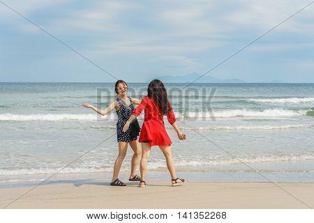 Young Girls Smiling On China Beach Of Danang