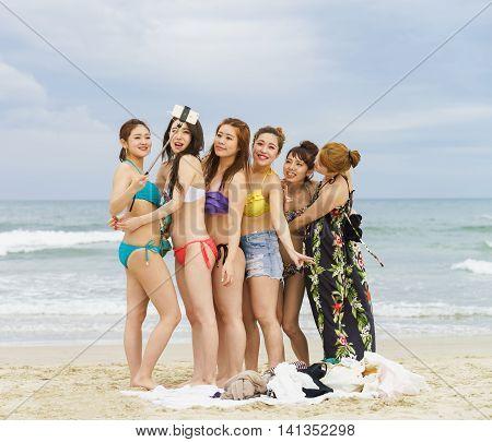 Young Girls Using Selfie Stick At China Beach In Danang