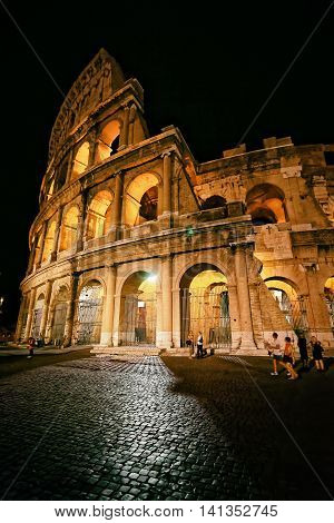 Colosseum In City Center Of Rome Italy At Dusk