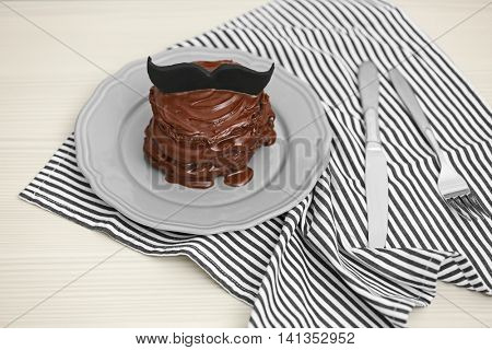 Chocolate pancakes with mustache on table. Happy fathers day concept