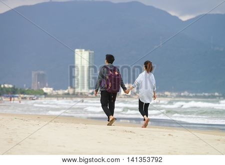 Young Couple Holding Hands In The China Beach In Danang