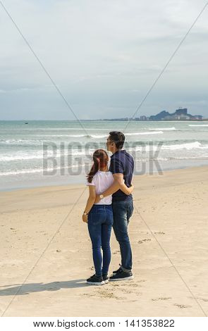 Young Couple Looking At Sea In China Beach Of Danang