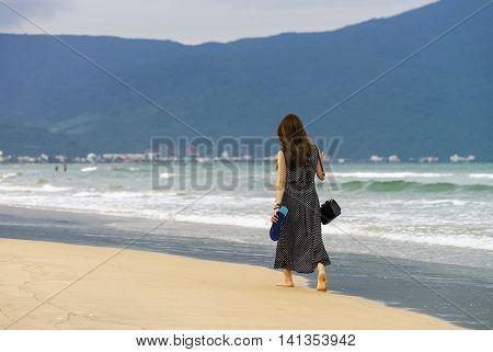 Young Girl Passing By At China Beach Of Danang
