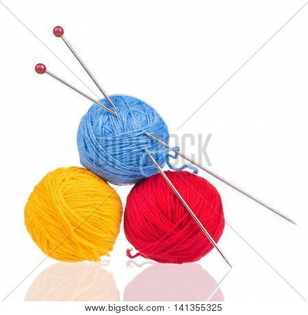 Bright woolen yard with spokes over white background