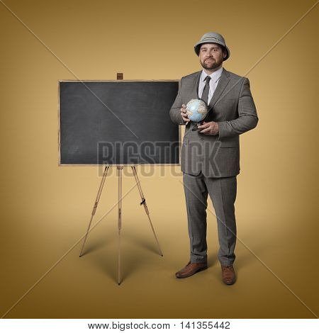 Explorer businessman holding earth on hand with blackboard