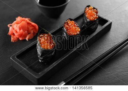 Sushi roll set on dark background