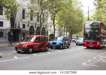 LONDON, UNITED KINGDOM - SEPTEMBER 12 2015: Aldwych street in London with par parked on the street and the traditional red bus
