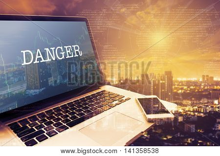 DANGER : Grey screen laptop computer. Vintage effects. Digital Business and Technology Concept.