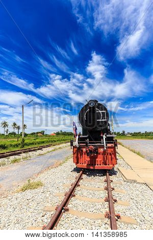 Antique Steam Trains In The Station With Blue Sky Background