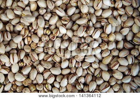 Pistachios  in opens shells bulk foods for market close-up