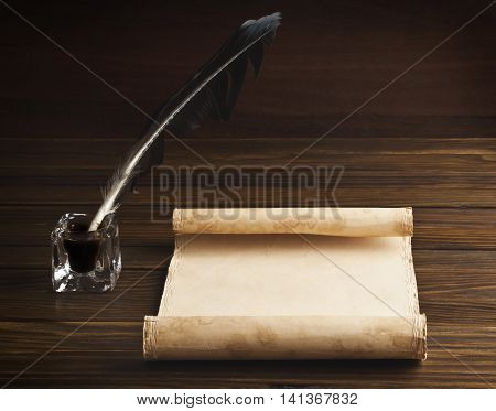 Clean old paper with space for your text, pen and inkwell on wooden background